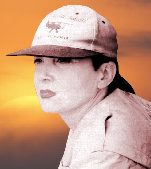 A black-and-white photo of author Susan St. John, on a sepia-toned backdrop. She's wearing a t-shirt and a baseball cap, gazing into the distance.